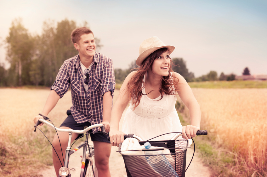 Happy couple riding bicycles